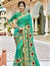 image of Party Style Fancy Embroidered Saree In Georgette Fabric Cyan With Lace Border