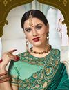 photo of Function Wear Art Silk And Net Fabric Teal Color Embroidered Designer Saree
