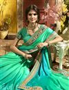 photo of Party Wear Georgette Cyan Embroidered Saree With Lace Border
