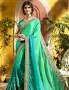image of Party Wear Georgette Cyan Embroidered Saree With Lace Border