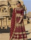 image of Embroidered Maroon Designer Lehengas In Raw Silk Fabric With Beautiful Blouse