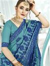 photo of Thread Embroidered Function Wear Fancy Fabric Saree In Cyan