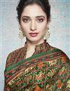 photo of Tamannaah Bhatia Dark Green Linen Fabric Festive Wear Fancy Printed Saree