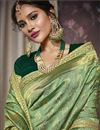 photo of Party Wear Green Art Silk Fabric Embellished Saree