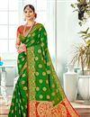image of Jacquard Work Banarasi Silk Fabric Occasion Wear Dark Green Saree With Designer Blouse