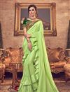 image of Embroidery Designs On Art Silk Fabric Green Party Wear Ruffle Saree With Mesmerizing Blouse
