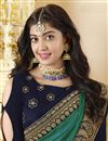 photo of Navy Blue Georgette Party Style Designer Saree With Heavy Lace Border
