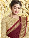 photo of Party Style Georgette Designer Saree In Maroon With Fancy Border Work