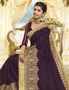 photo of Party Style Georgette Designer Saree In Wine With Heavy Lace Border