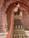 photo of Embroidery Designs On Wine Velvet Fabric Wedding Wear Lehenga