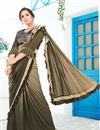 image of Dark Beige Color Party Wear Ruffle Border Saree In Lycra With Fancy Work And Beautiful Blouse