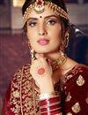 photo of Velvet Fabric Maroon Color Bridal Wear Lehenga Choli With Embroidery Work