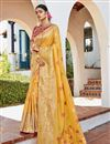 image of Jacquard Silk Fabric Puja Wear Yellow Color Trendy Weaving Work Saree