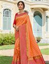 image of Sangeet Wear Elegant Orange Color Weaving Work Saree In Banarasi Style Silk