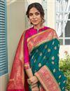 photo of Banarasi Style Silk Sangeet Wear Teal Color Elegant Weaving Work Saree