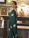 photo of Puja Wear Satin Silk Fabric Fancy Weaving Work Saree In Dark Green