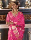 photo of Pink Puja Wear Fancy Satin Silk Fabric Weaving Work Saree