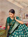 photo of Art Silk Fabric Puja Wear Classic Teal Color Weaving Work Saree