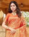 photo of Art Silk Fabric Sangeet Wear Orange Color Weaving Work Saree