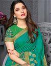photo of Tamanna Bhatia Cyan Color Sangeet Wear Embroidered Border Work Saree In Art Silk Fabric