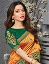 photo of Tamanna Bhatia Party Wear Art Silk Fabric Orange Color Embroidered Border Work Saree