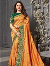 image of Tamanna Bhatia Party Wear Art Silk Fabric Orange Color Embroidered Border Work Saree