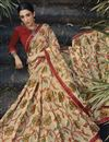 photo of Festive Wear Brasso Fabric Fancy Beige Color Printed Saree