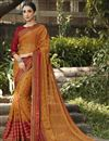 image of Brasso Fabric Festive Wear Orange Color Fancy Printed Saree