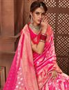 photo of Occasion Wear Brocade Weaving Saree In Rani Color With Designer Blouse