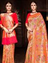 image of Eid Special Weaving Work Designs On Silk Fabric Orange Color Party Wear Saree