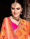photo of Weaving Work Designs On Orange Color Silk Fabric Party Wear Saree
