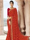image of Georgette Fabric Fancy Festive Wear Red Lehariya Printed Saree