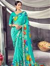 image of Daily Wear Classic Cyan Color Printed Georgette Fabric Saree