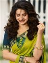 photo of Eid Special Prachi Desai Embroidery Designs On Art Silk Occasion Wear Saree In Green Color With Enticing Blouse