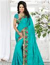 image of Lovely Georgette Designer Saree In Cyan Color With Embroidered Border