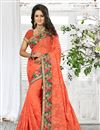 image of Lovely Georgette Designer Saree In Orange Color With Embroidered Border
