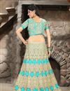 photo of Turquoise Color Bridal Wear Embroidered Net Lehenga Choli