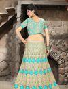 photo of Turquoise Color Bridal Wear Embroidered Net Lehenga Choli