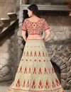photo of Beige Color Bridal Wear Embroidered Net Lehenga Choli