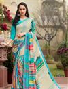 image of Crepe Regular Wear Beige And Turquoise Color Saree With Unstitched Blouse
