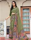 image of Daily Wear Fancy Print Mehendi Green Color Crepe Saree
