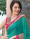 photo of Brilliant Teal Color Party Wear Printed Georgette Saree