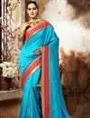 image of Lovely Cyan Color Tantalizing Dhupion And Silk Designer Embroidered Saree