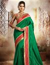 image of Elegant Green Color Festive Wear Dhupion And Silk Saree With Embroidery Work