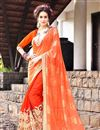 image of Riveting Orange Color Designer Georgette And Net Party Wear Saree With Embroidery Work