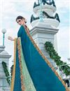 photo of Scrupulously Embroidered Designer Blue Color Georgette And Net Saree