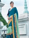 image of Scrupulously Embroidered Designer Blue Color Georgette And Net Saree