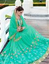 photo of Georgette And Net Designer Green Color Festive Wear Saree With Embroidery