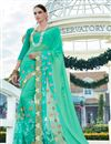 image of Green Color Georgette And Net Party Wear Designer Saree With Unstitched Blouse