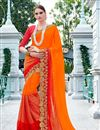 image of Designer Georgette And Net Party Wear Saree With Embroidery In Orange And Red Color